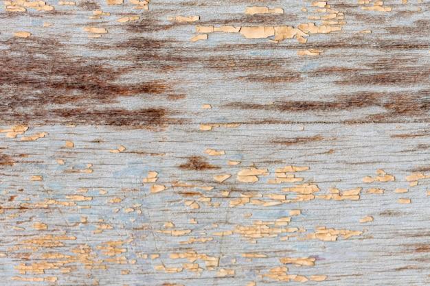 Dipinga la scheggiatura su superficie di legno invecchiata