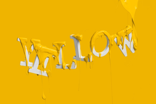 Dipingi gocciolare sulla parola gialla galleggiante