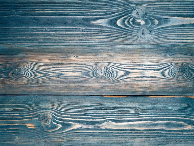 Dipinto in blu, blu scuro, fondo in legno da tavole di pino,