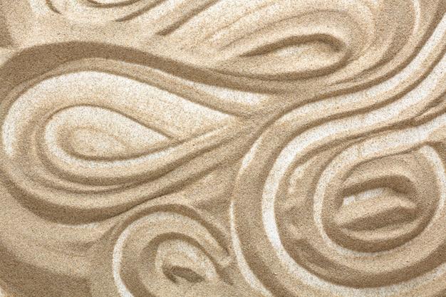 Disegni nella sabbia. terapia artistica.