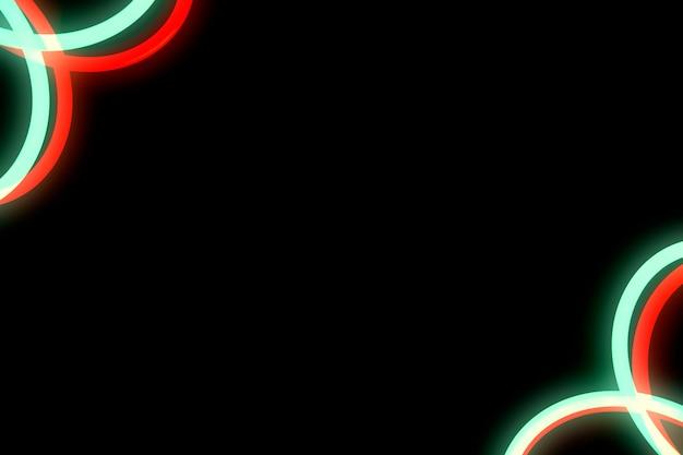 Disegno curvo al neon rosso e verde sull'angolo di sfondo nero