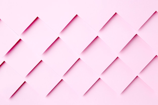 Disegno di sfondo di forme di carta rosa