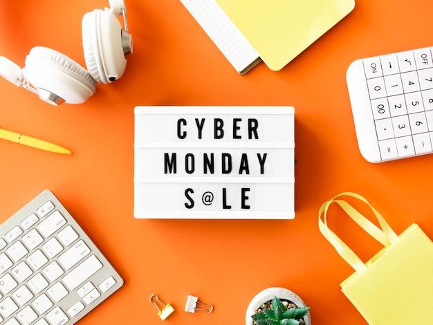 Disposizione piatta della scatola luminosa con calcolatrice e borsa della spesa per il cyber lunedì
