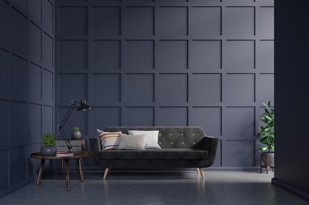 Divano scuro contro il muro blu scuro con armadietto, tavolo, lampada, libro sul muro scuro