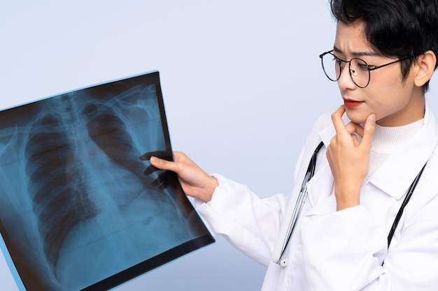 Doctor asian woman holding a bone scan