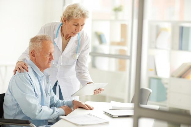 Doctor consulting elderly man