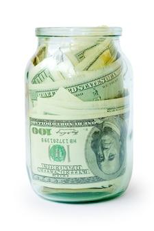 Dollari dei soldi nel vaso isolato su bianco