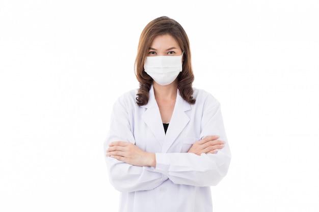 Donna asiatica nella maschera da portare del vestito dall'abito.