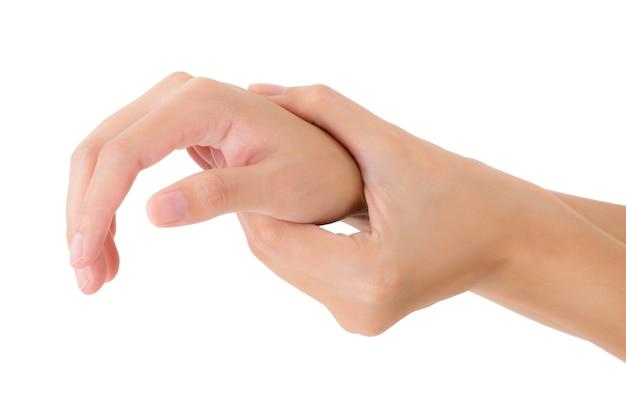 Donna che tiene il suo polso e che massaggia nell'area di dolore isolata su bianco