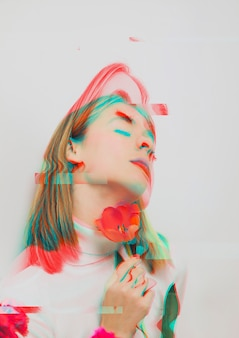 Donna che tiene un fiore del papavero nell'effetto 3d