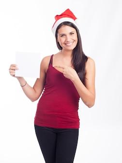 Donna di santa che mostra carta o nota in bianco