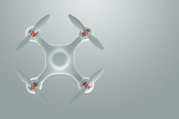 Drone, quadrocopter bianco su una priorità bassa bianca con lo spazio della copia. vista dall'alto, piatta distesa
