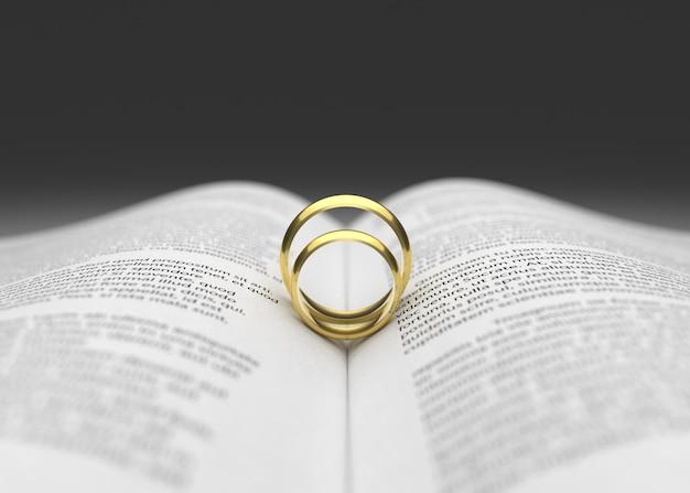 Due fede nuziale sulla rappresentazione della pagina del libro 3d