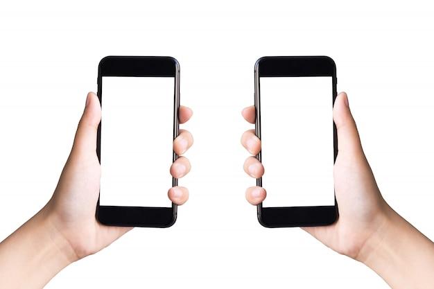 Due mani che tengono gli smart phone su bianco con il percorso di ritaglio