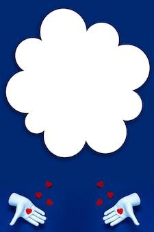 Due mani lanciano cuori rossi su sfondo blu. il concetto per san valentino