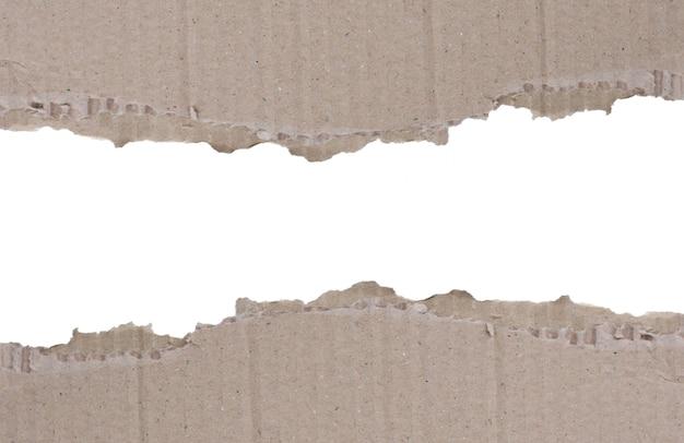 Due scarti della priorità bassa lacerata del cartone ondulato