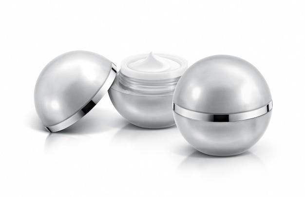 Due vasetti cosmetici con sfera d'argento