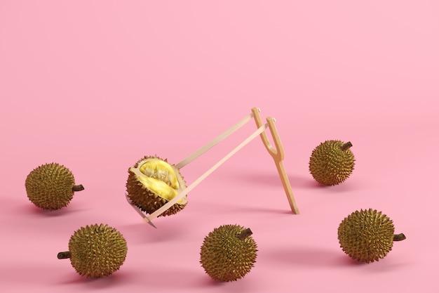Eccezionale durian maturo tagliato fresco in una fionda circondata su sfondo rosa