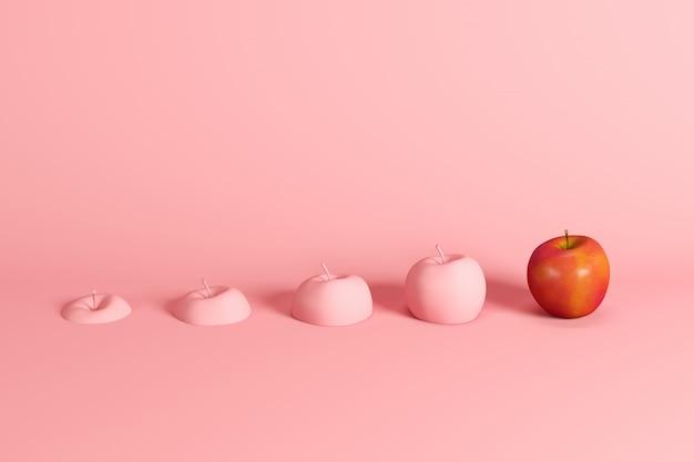 Eccezionale mela rossa fresca e fette di mela dipinte in rosa su sfondo rosa