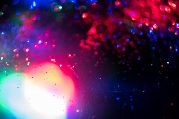 Effetto di illuminazione bokeh glitter glitter colorato astratto sfondo sfocato
