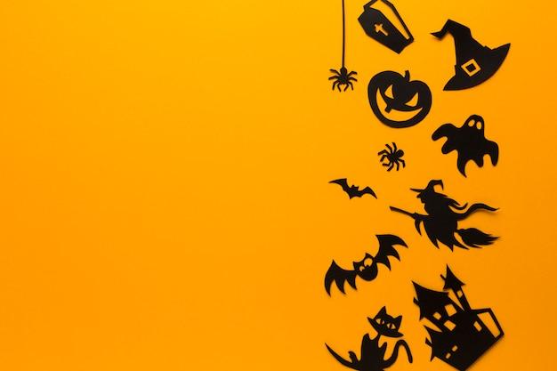 Elementi del partito di halloween su fondo arancio