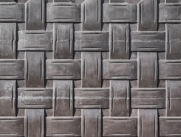 Elemento di recinzione in cemento, tessitura imitazione.