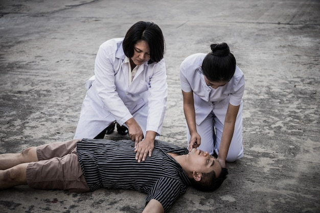 Emergency cpr on a man, nurse try to process resuscitation (primo soccorso)