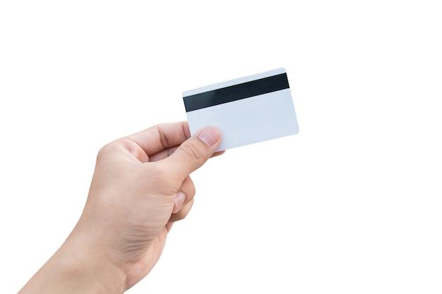 Equipaggi la mano che tiene la carta di credito bianca isolata