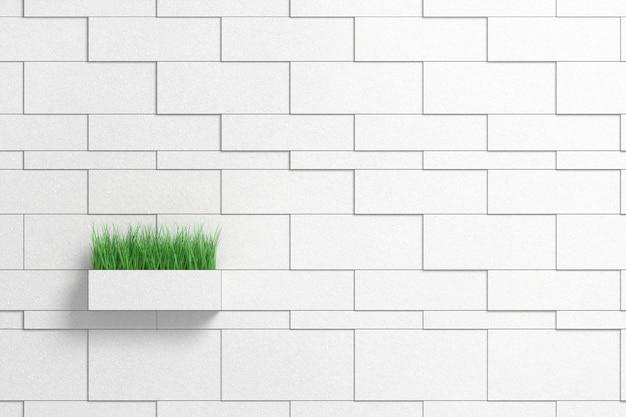 Erba alta verde che sporge da un vaso di fiori a forma di mattone esteso da un muro grigio mattone
