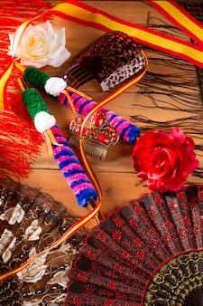 Espana dalla spagna con il pettine di flamenco del fan della bandiera della rosa