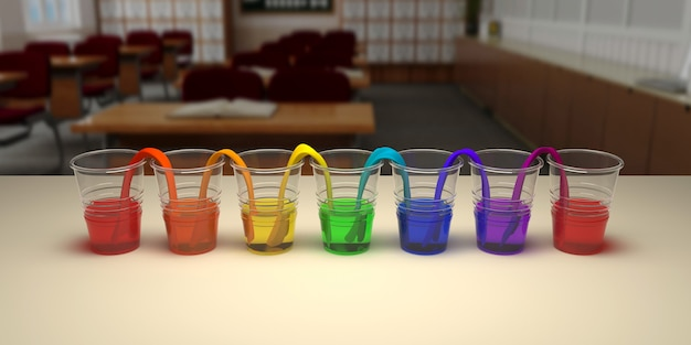 Esperimento di camminata dell'acqua dell'arcobaleno in aula. concetto di scienza. bicchieri in fila con acqua colorata e carta bagnata tra.