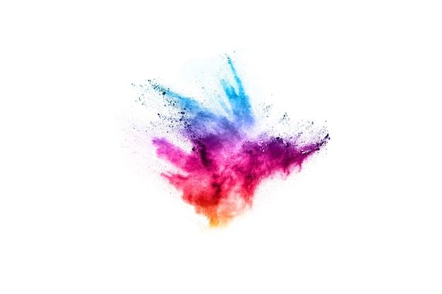Esplosione di polvere colorata su sfondo bianco. nuvola colorata la polvere colorata esplode.