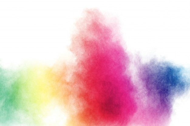 Esplosione di polvere multicolore astratta su sfondo bianco.