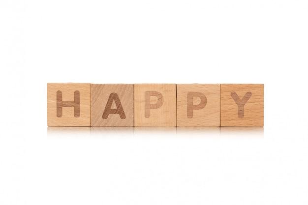 Esprima i piccoli cubi di legno felici con le lettere isolate su fondo bianco con lo spazio della copia