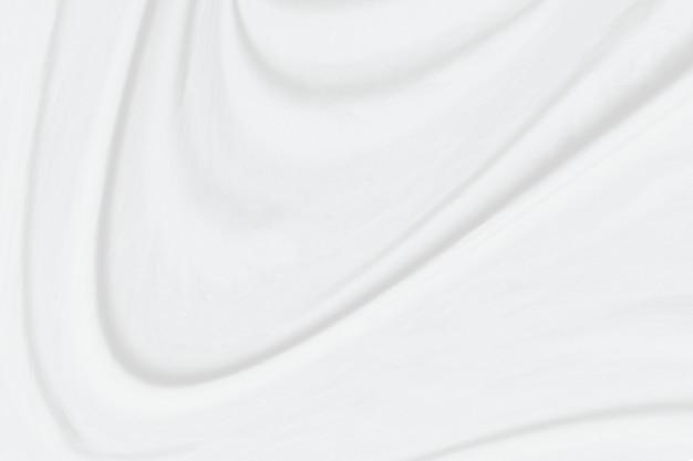 Estratto bianco del fondo del panno con le onde molli.