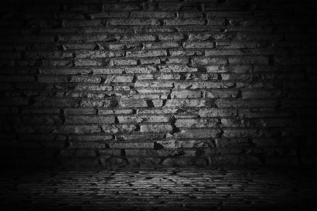 Estratto del mattone di cemento nero con bordo vignetta nero backgroun