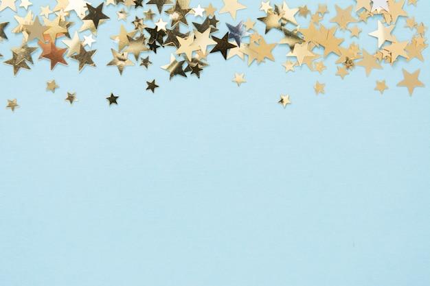 Estratto di scintillio dorato a forma di stella
