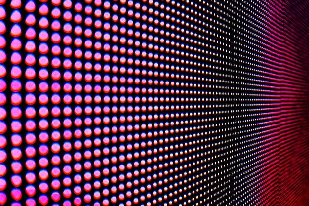 Estratto vicino sul fondo colorato luminoso dell'estratto della parete video del led smd