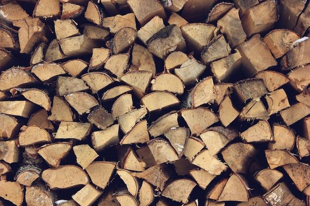 Estremità del fondo di legno dei ceppi. tonificante. legno nello stack.