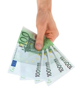 Euro soldi in una mano isolata su bianco