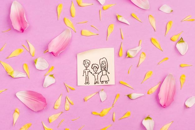 Famiglia disegno su carta tra petali freschi