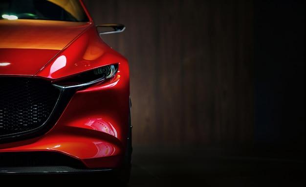 Fari dell'automobile rossa moderna su priorità bassa nera