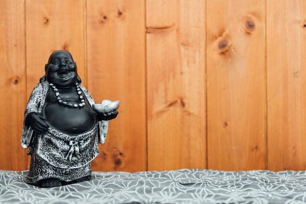 Fat laughing buddha, hotei dio left.