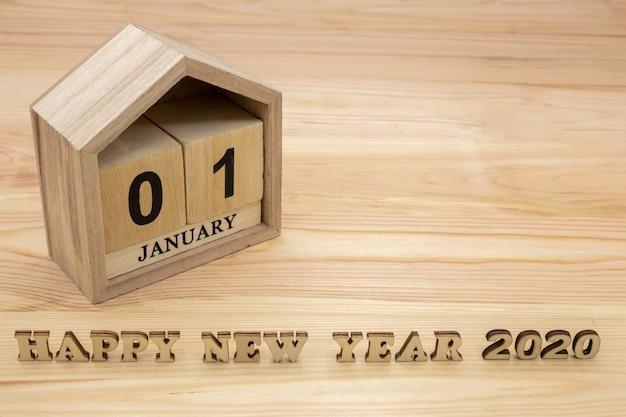 Felice anno nuovo 2020 e calendario casa in legno
