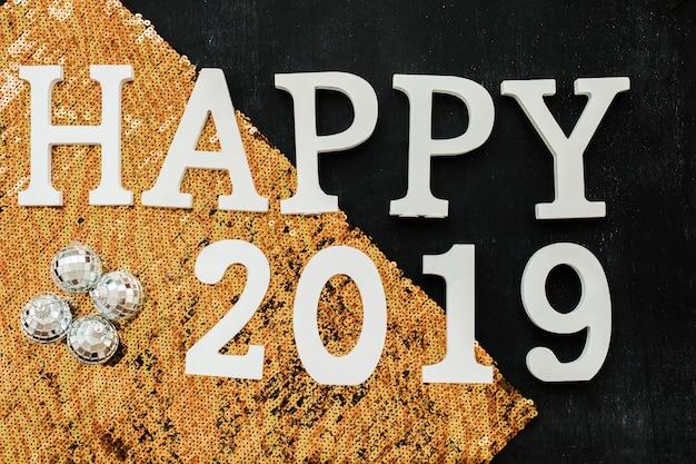 Felice iscrizione 2019 con lustrini arancioni