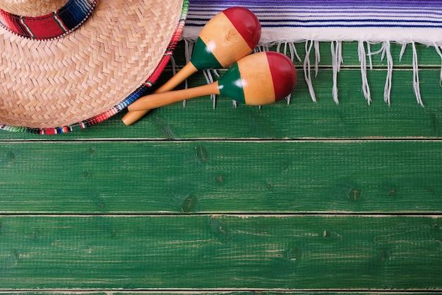Festa messicana di maracas del sombrero del confine del fondo del messico