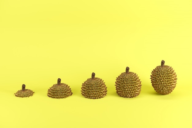 Fette di durian maturo su sfondo giallo concetto di idea di frutta minima.