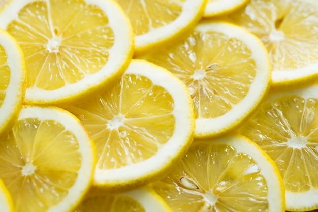 Fette di modello giallo fresco del fondo di struttura del limone