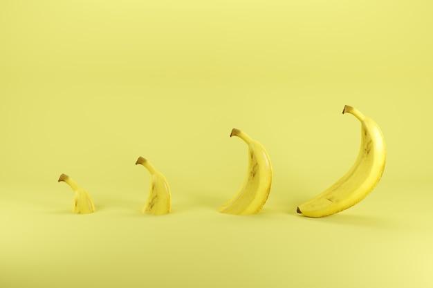 Fette di singola banana matura su sfondo giallo pastello