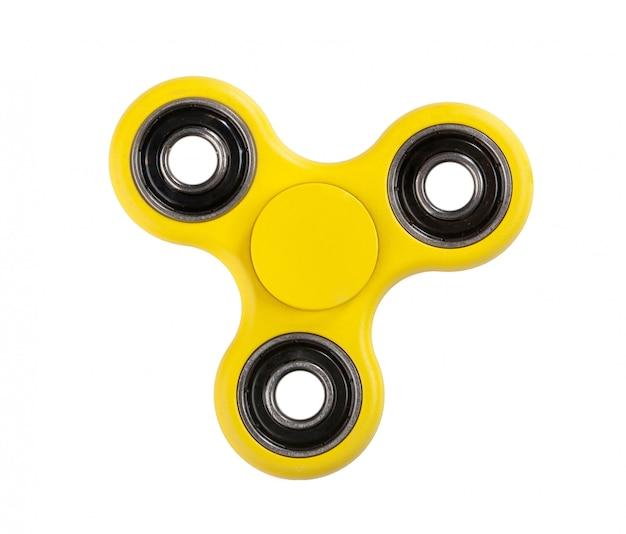 Fidget spinner giallo su sfondo bianco